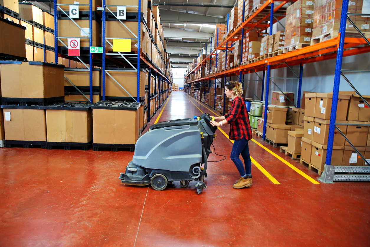 woman doing cleaning in warehouse